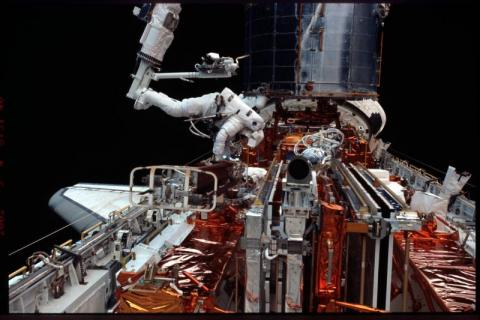 Astronaut Michael Massimino Working on Hubble  Tragedies and Triumphs American History Aviation & Space Exploration STEM