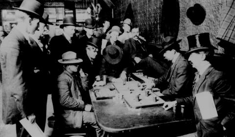 Photograph taken at the Orient Saloon in Bizbee, Arizona depicting the game of Faro