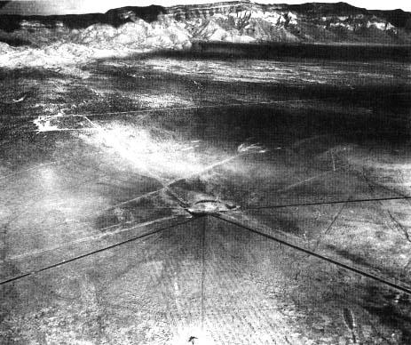 An aerial photograph of the Trinity test site taken after the July 16, 1945 Explosion