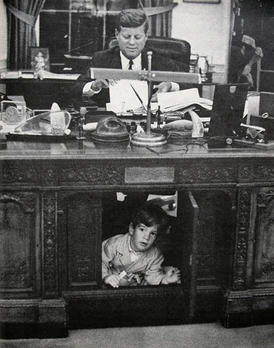 John f kennedy jr playing in the resolute desk for Jfk in oval office