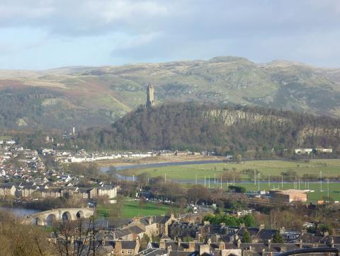Stirling Castle with view of Abbey Craig and the Wallace Monument