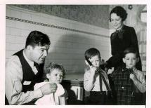 Jim and Mae Braddock with Their Three Children