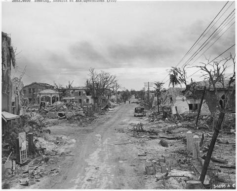 Scenes of wreckage in the town of Garapan, Saipan, Island World History World War II
