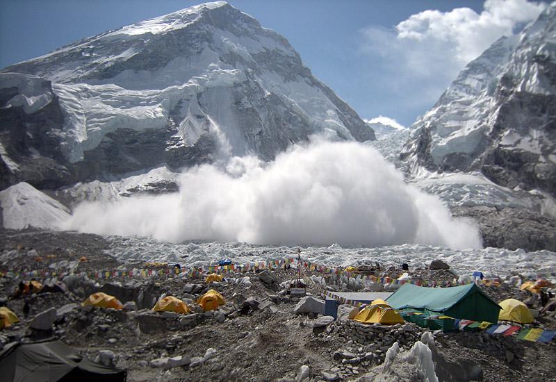 avalanche near the khumbu icefall on mount everest