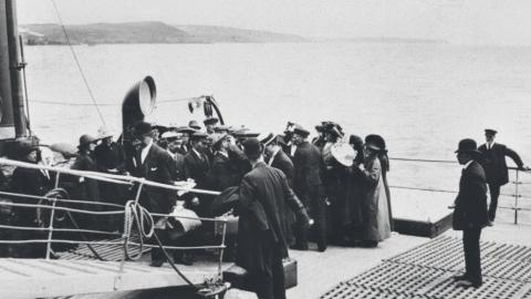 Photo of a scene that depicts checking Titanic passengers for disease